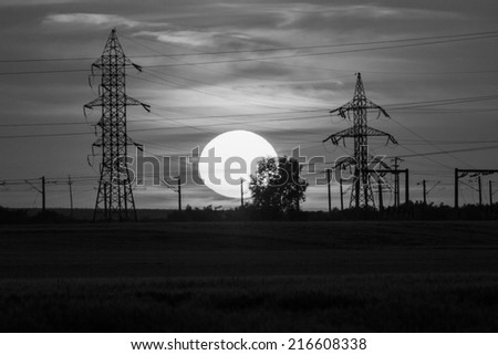 Beautiful, dramatic, clouds and sky at sunset. Image has grain texture seen at its maximum size. Black and white photography - stock photo