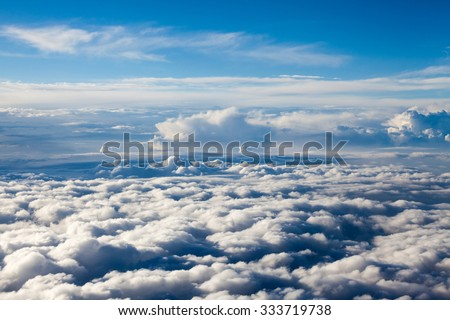 Beautiful, dramatic clouds and sky viewed from the plane - stock photo
