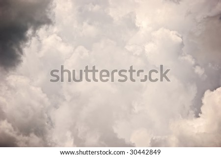 beautiful dramatic image of storm clouds gathering filling the image and sky suitable as background - stock photo