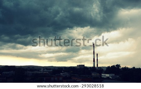 Beautiful dramatic sky over power plant - stock photo