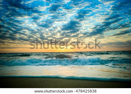 Beautiful dramatic sky over the beach as background
