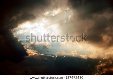 Beautiful dramatic sky with sun rays. heavenly background. - stock photo