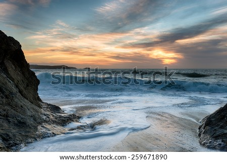 Beautiful dramatic stormy sunset at Little Fistral beach at Newquay on the north coast of Cornwall - stock photo