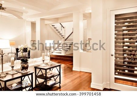 Beautiful drawing room with glossy wooden floor at night - stock photo