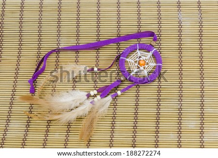 Beautiful dream catcher on bamboo mat background