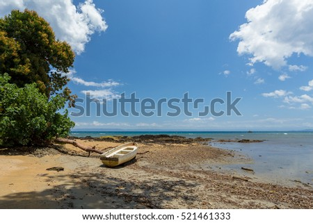 Beautiful dream paradise beach with boat in Masoala national park, Madagascar. Blue sky and clear sea, Wilderness virgin nature scene
