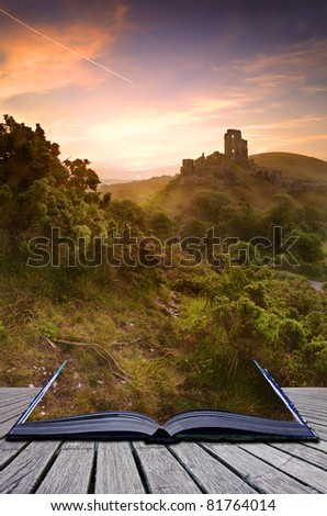 Beautiful dreamy fairytale castle ruins against romantic colorful sunrise coming out of pages in magical book creative concept - stock photo