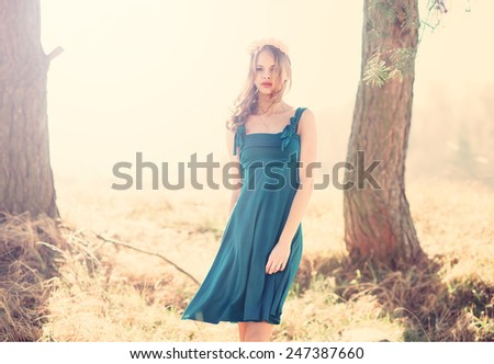 beautiful dreamy girl in a blue dress in the spring - stock photo