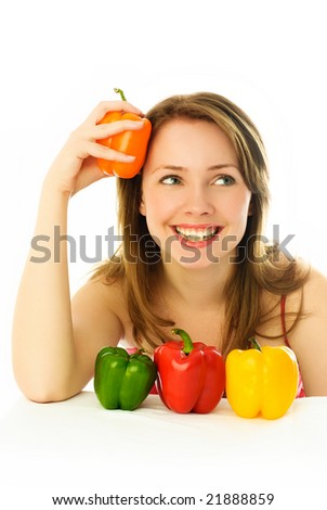 beautiful dreamy young brunette woman with colorful peppers