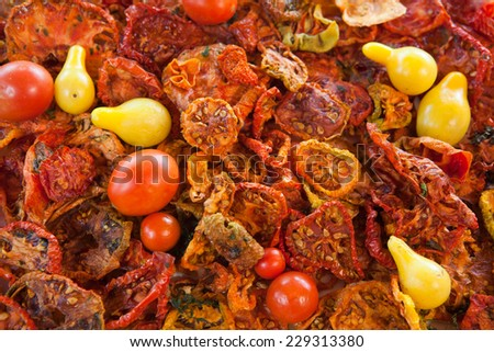 Beautiful dried and fresh tomatoes background - stock photo