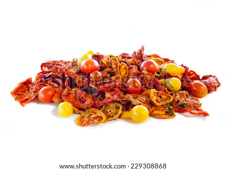 Beautiful dried and fresh tomatoes on white - stock photo