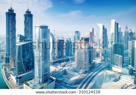 Beautiful Dubai city, bird eye view on majestic cityscape with modern new buildings, daytime panoramic scene, United Arab Emirates - stock photo