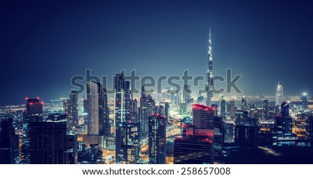 Beautiful Dubai cityscape, bird's eye view on a night urban scene, modern city panoramic landscape, United Arab Emirates - stock photo