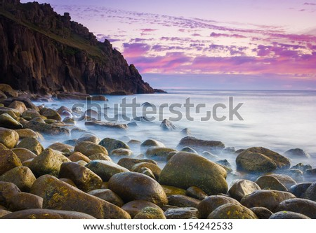 Beautiful dusk at the remote Porth Loe Cove Cornwall England UK
