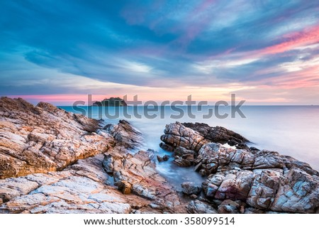 beautiful dusk over the sea with rocks and sunset glow in koh samet island,thailand. - stock photo