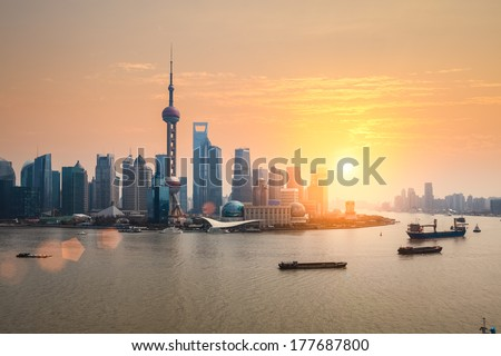 beautiful dusk scene of shanghai skyline and huangpu river - stock photo