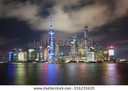 Beautiful dusk scene of shanghai skyline and huangpu river at night, China - stock photo