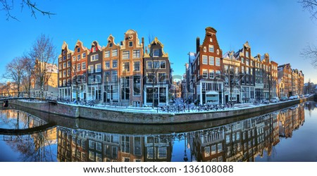 Beautiful early morning winter panorama of the Unesco world heritage city canals of Amsterdam, The Netherlands. HDR - stock photo
