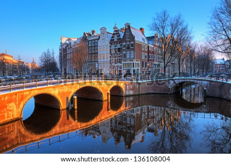 Beautiful early morning winter view on one of the Unesco world heritage city canals of Amsterdam, The Netherlands. HDR - stock photo