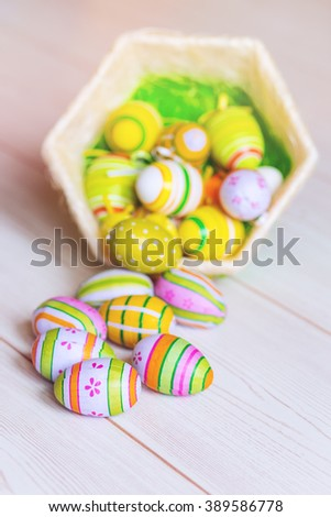 Beautiful easter egg decoration in  basket - stock photo