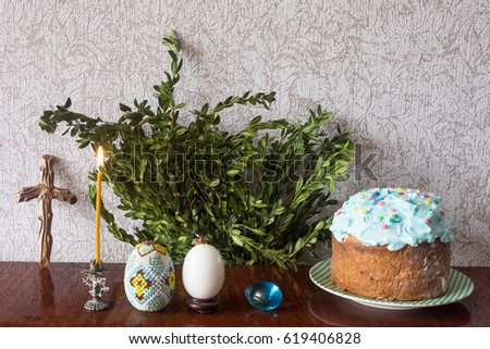 Beautiful Easter Eggs With Willow Lighted Candle And A Wooden Cross On