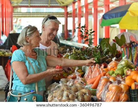 beautiful elderly couple in  market