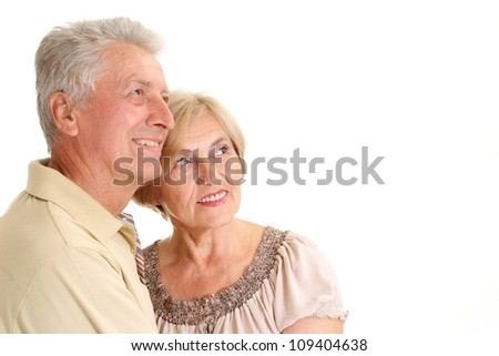 Beautiful elderly couple on a white background