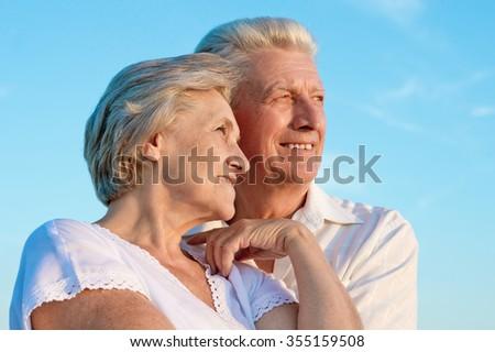 beautiful elderly couple  on the background of sky - stock photo