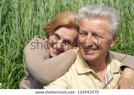 beautiful elderly couple together in a summer park