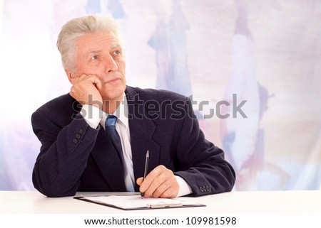 Beautiful elderly man, working in very different fields of activity - stock photo