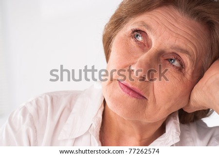 beautiful elderly woman in a white clothes