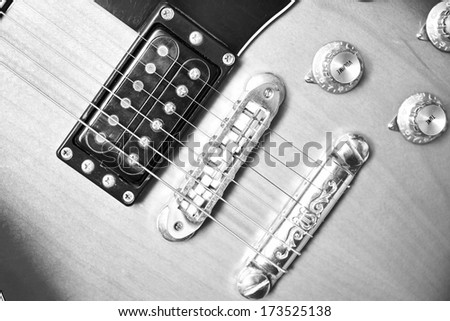 Beautiful Electric Guitar Standing Up Inside, close-up - stock photo
