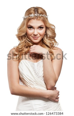 Beautiful elegance bride with beauty wedding coiffure in white dress - stock photo