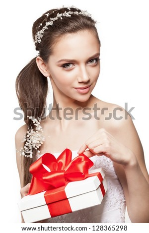 Beautiful elegance bride with small gift box - stock photo