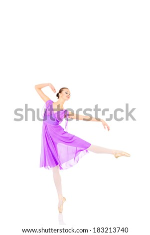 Beautiful elegant bellet dancer dancing at studio. Isolated over white.