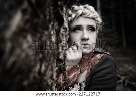 Beautiful elegant blonde woman in autumn forest