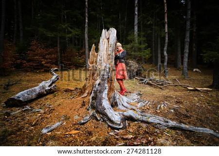 Beautiful elegant blonde woman in autumn forest - stock photo