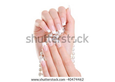 Beautiful elegant female hand with beauty french manicure over white background - stock photo
