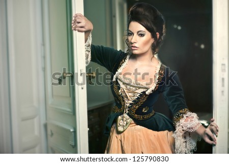 Beautiful, elegant lady in manor house - stock photo