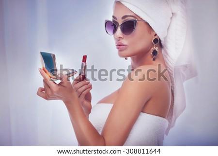 Beautiful elegant lady posing in bathroom, doing makeup. Luxury concept.  - stock photo