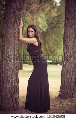 beautiful elegant mature woman portrait in the wood - stock photo