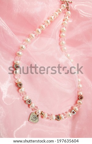 Beautiful elegant necklace of pearls and rock-crystal - stock photo
