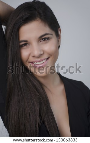 Beautiful elegant smiling young woman with gorgeous hair