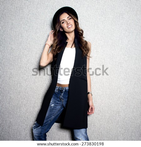 beautiful elegant woman holds  bag in hand walks on park. In  fashionable stylish image - stock photo