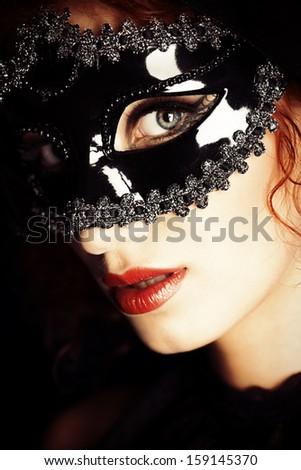 Beautiful elegant woman in carnival mask. - stock photo