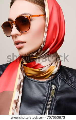 Woman With Sunglasses And Scarf On Head In Convertible