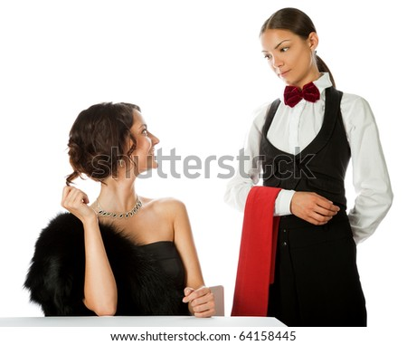 beautiful elegant woman making order to a waitress, isolated on white