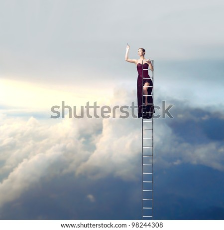 Beautiful elegant woman on a ladder in the sky drawing - stock photo