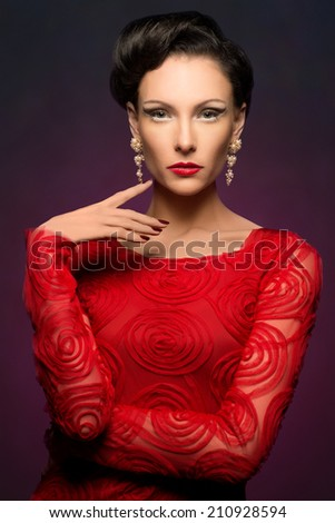 Beautiful elegant woman wearing red dress and lovely makeup - stock photo