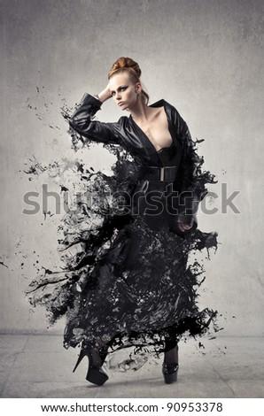 Beautiful elegant woman with her dress melting - stock photo